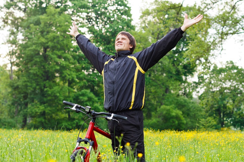 Happy recovering alcoholic enjoying a bike ride in the woods